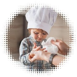 Child having hands cleaned in kitchen. Used to show increased hygiene in fast food industry.