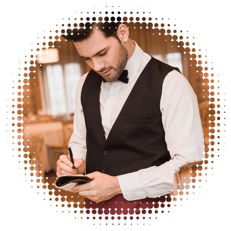 Waiter Taking An Order At A Restaurant